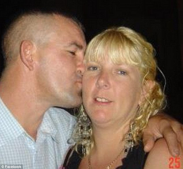 Affection: Mr Hewitt's Facebook profile picture shows him kissing a blonde woman