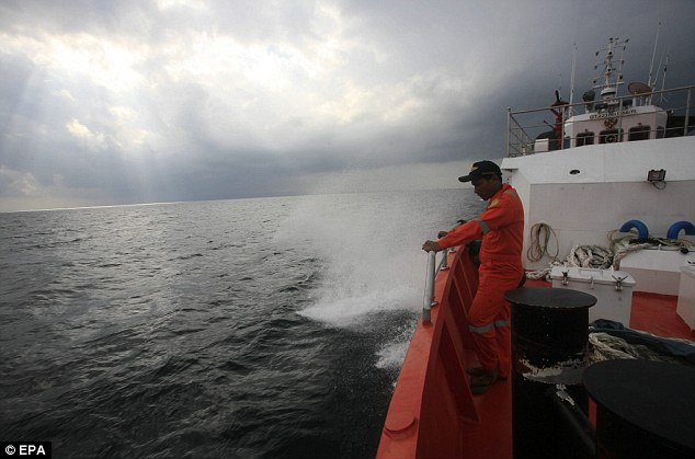 Expanded search: Indonesian Search And Rescue personnel keep a lookout on a rescue ship heading to the Andaman sea