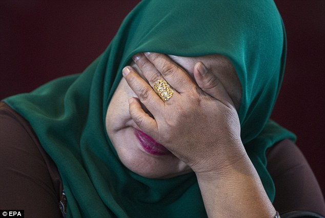 Devastated: Kamariah Sharif, a relative of one of the missing passengers gets emotional before the announcement the plane was hijacked