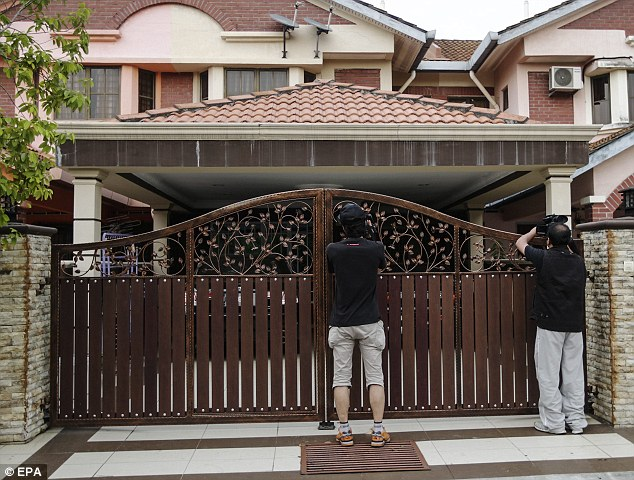 Entrance: The gates outside the home of co-pilot Fariq Abdul Hamid which has been searched by police