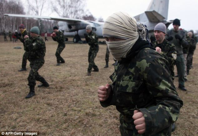Ukrainian interim forces officer new recruits learn techniques of unarmed combat