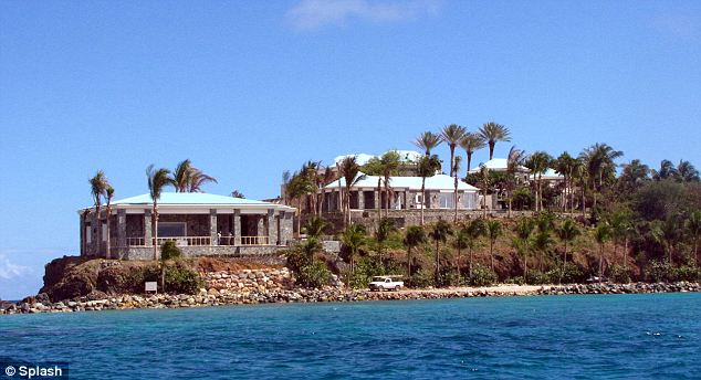 Pedophile paradise: The lawsuit included flight records that showed Clinton made multiple trips to Epstein's private island, Little St James (pictured), between 2002 and 2005. Women were reportedly kept there as sex slaves