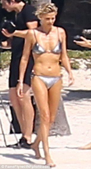 Charlize Theron Sizzles In Our Bikinis During Beachside