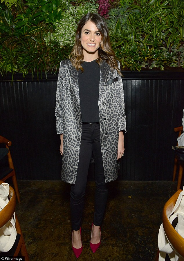 Vamp: Nikki Reed covered up in a leopard print jacket and killer red heels at a fashion event in Los Angeles on Thursday