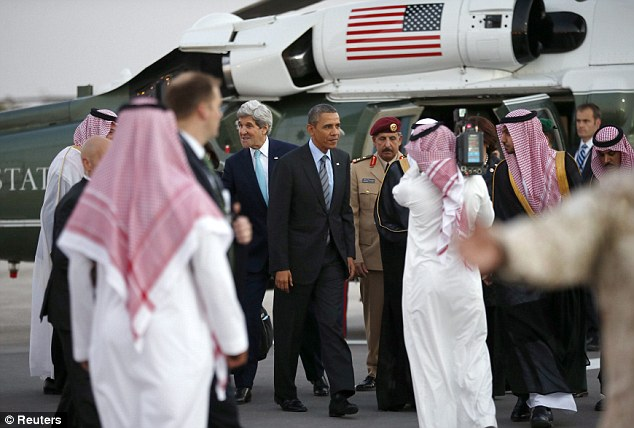 President Obama, accompanied by U.S. Secretary of State John Kerry,  are greeted upon their arrival at Rawdat al-Khraim Desert Camp for the meeting with the Saudi king