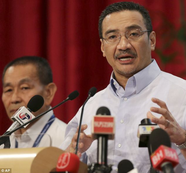 Malaysia's acting Transport Minister Hishammuddin Hussein, right, said MI6 and the CIA are working with Chinese spy agencies to try and find out why the plane suddenly changed course