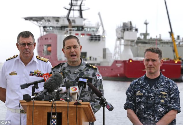 U.S. Navy Captain Mark Matthews, right, said today finding the missing Malaysian Airlines jet would be an enormous task - one that may never be achieved due to a series of complications