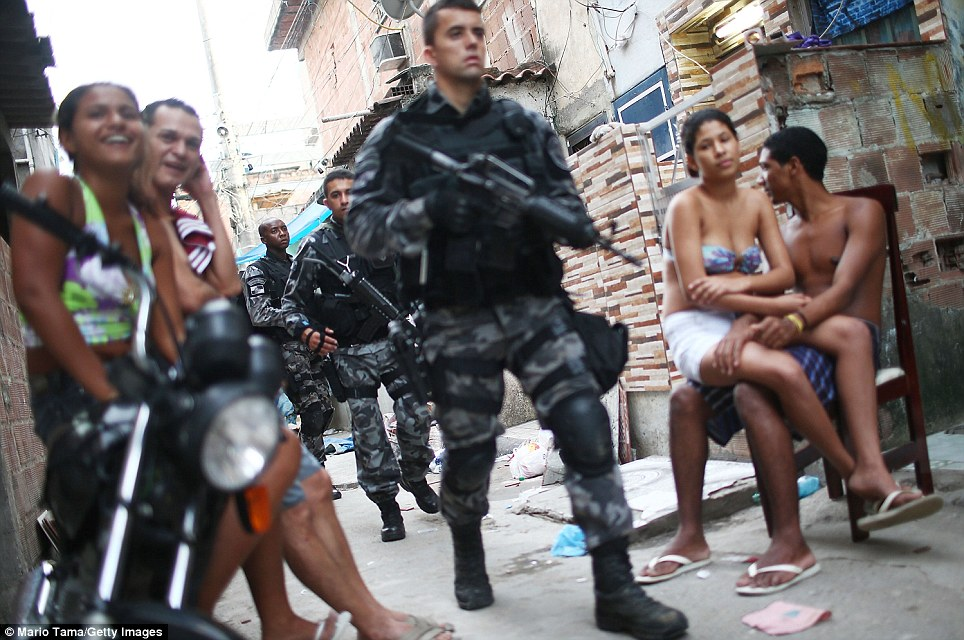 Locals carried on with daily life as police officers and marines in uniform filed through the narrow streets. No shots have been fired so far