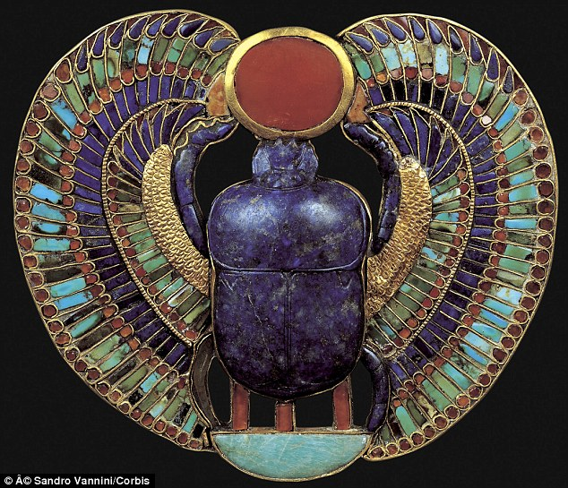 Priceless: A pendant found in Tutankhamun's tomb. It forms a rebus for his throne name Nebkheperure and is made of gold set with inlays of colored glass and semiprecious stones