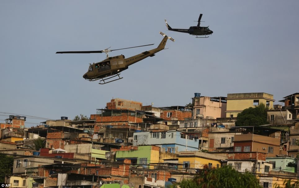 Helicopters circle the Mare slum complex in Rio de Janeiro. The slum - 'favela' in Portuguese - is home to some 130,000 residents