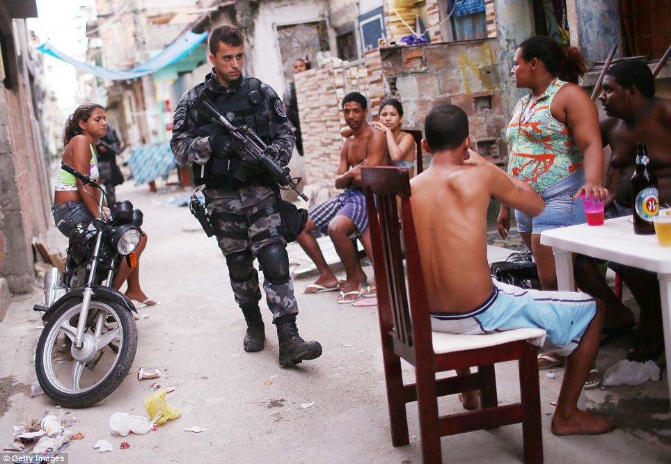 Residents looked on bemusedly as armed federal officers in bullet-proof vests strode through the run-down streets in a bid to crack down on crime