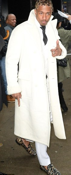 Bundled up: He donned a long white coat to keep warm as he headed out after the appearance