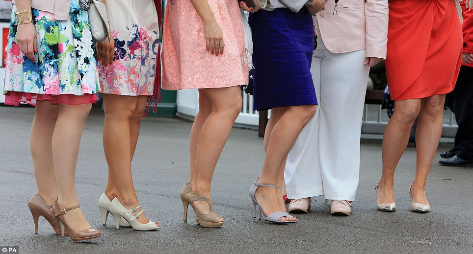 Pretty: While platforms remain de rigeur at Aintree, not everyone is wedded to sky-high heels - as this group of smartly dressed racegoers prove