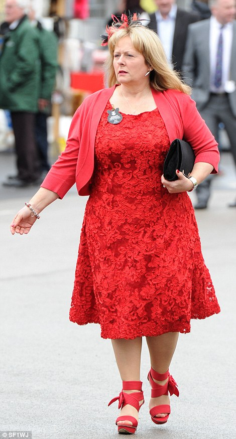A racegoer shows off her all-red ensemble