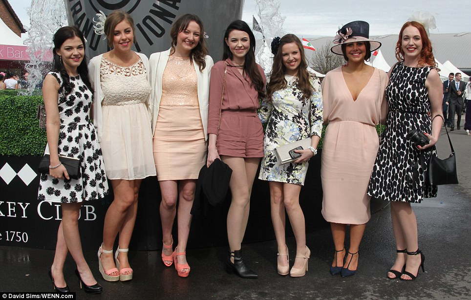 Looking lovely: A group of smartly dressed racing fans demonstrate how to do racecourse chic Aintree style on Ladies Day at the Grand National Festival