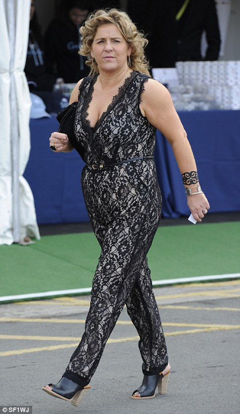 A racegoer plumps for a daring lace jumpsuit