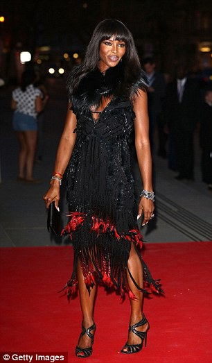 Naomi was beaming at the preview of The Glamour of Italian Fashion exhibition on Tuesday night - the same night she was later seen canoodling with Michael Fassbender