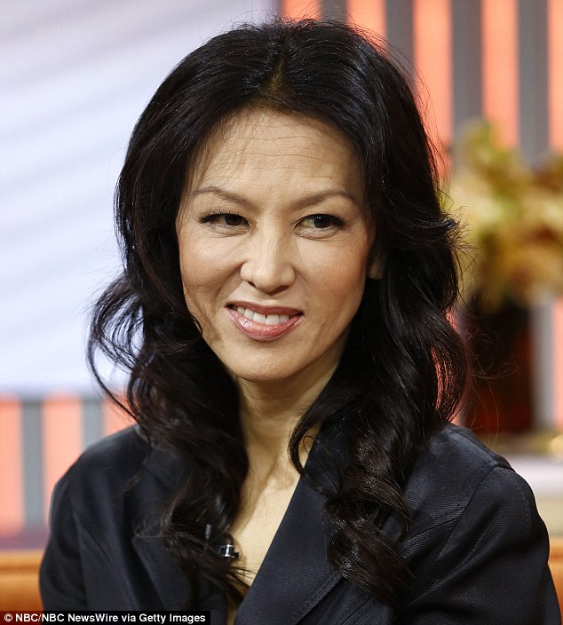 No more 'tiger moms': the study's found that socioeconomic factors may be the reason for Asian Americans' success -- as opposed to strict parenting techniques, like the ones made famous by Amy Chua (pictured)