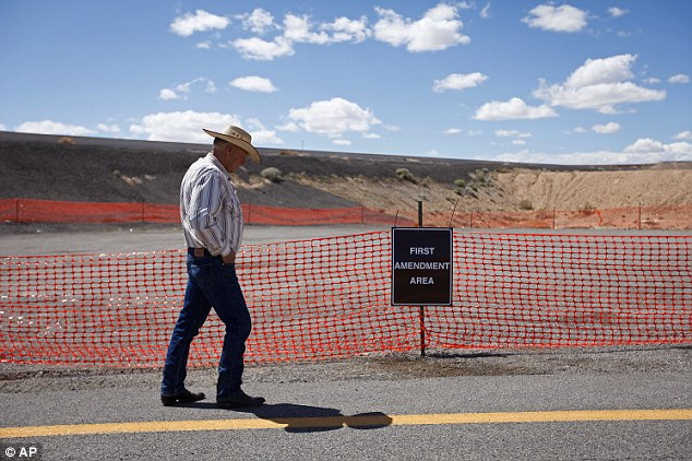 Free speech? Cliven Bundy walks by a first amendment area set up by the Bureau of Land Management near Bunkerville