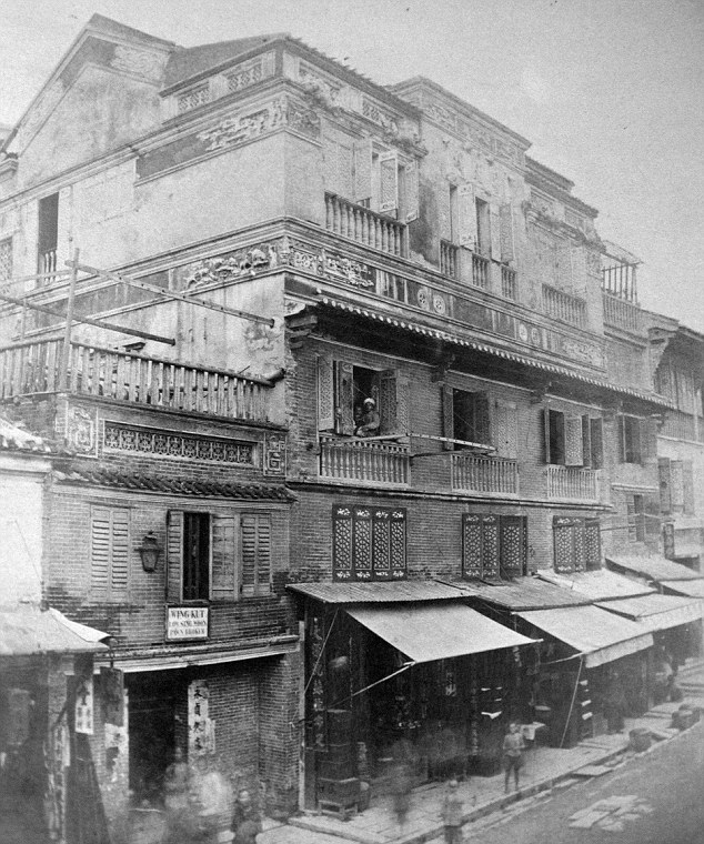 Real life: The image shows shops and houses in Tai Ping Shan Street in Hong Kong. In 1860 Chinese writer Wang Tao said the street was full of brothels with 'brightly painted doors and windows with fancy curtains'