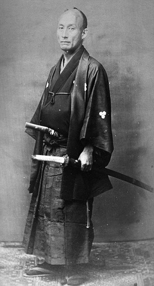 A Japanese servant or Kerai photographed for the China Magazine in the 1860's