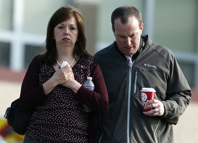 A man and woman walk away from Franklin Regional High School after more then a dozen students were stabbed by a knife wielding suspect at the school on Wedne...