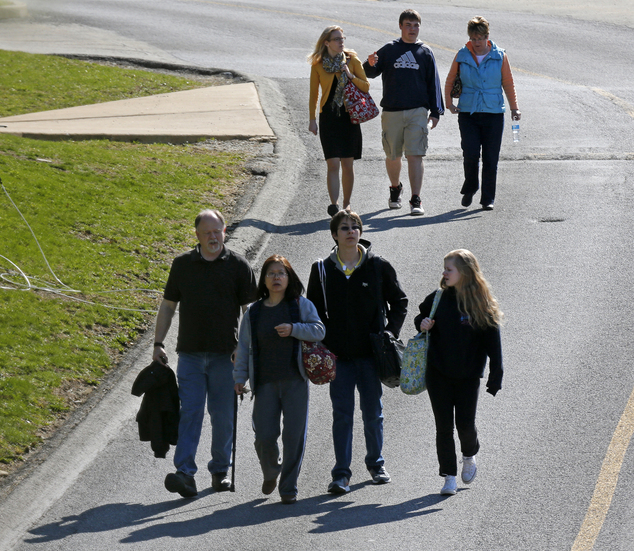 Students are escorted from the campus of the Franklin Regional School District after more then a dozen students were stabbed by a knife wielding suspect at n...