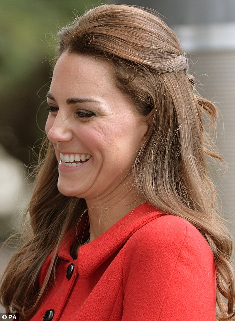 Classic: The 32-year-old also wore her glossy long brunette locks in a half up and half down style to reveal a pair of pearl drop earrings
