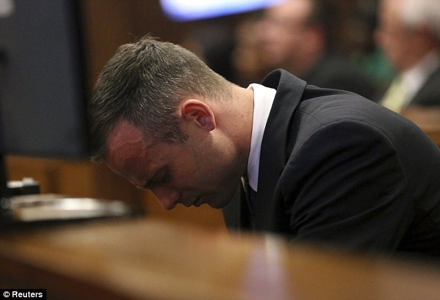Time for reflection: The athlete bows his head in the dock after finishing his testimony at his murder trial