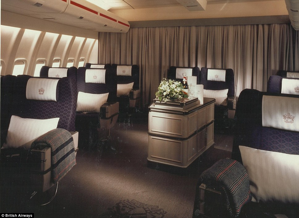 Dated: First class style in 1989 featured heavy draped curtains, purple seating and floral decoration