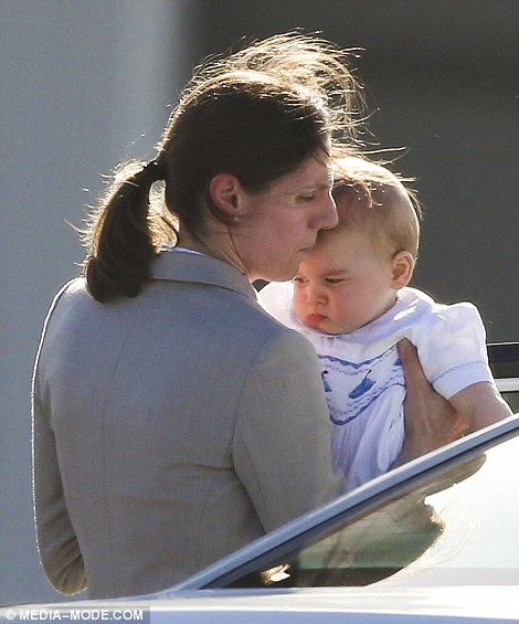 Moody: George looked less than impressed as his nanny Maria Teresa carried him upon the family's arrival in Sydney