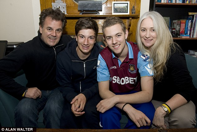 Tombides was diagnosed with cancer in 2011 and he died today with his family at his bedside. He is pictured (second right) with his father, Jim, brother, Taylor, and mother, Tracylee