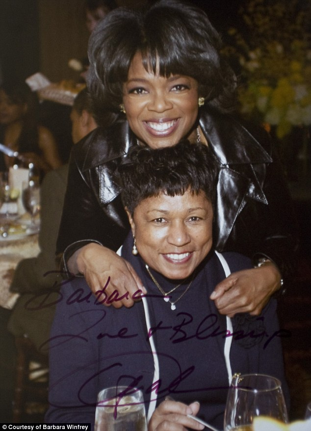 Love-less: 'Love & Blessings' Oprah wrote on this photograph of her and Barbara taken at the superstar's 50th birthday party in Chicago in 2004. But Oprah hasn't shown her stepmother much love in words or deed over the years