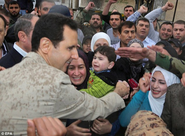 Syrian President Bashar al-Assad marked Easter by visiting a Christian town near Damascus recently recaptured by his forces, state media reported. The claims come days ahead of an April 27 deadline for Assad's government to have handed over Syria's chemical weapons stockpiles for destruction