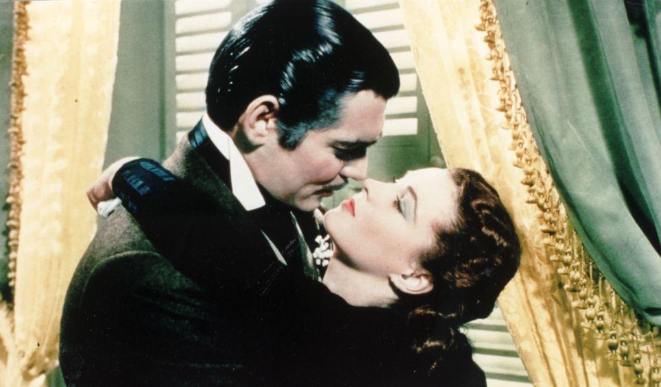 Leigh em seu papel mais famoso como Scarlett O'Hara com Clarke Gable em 1939 clássico E o Vento Levou