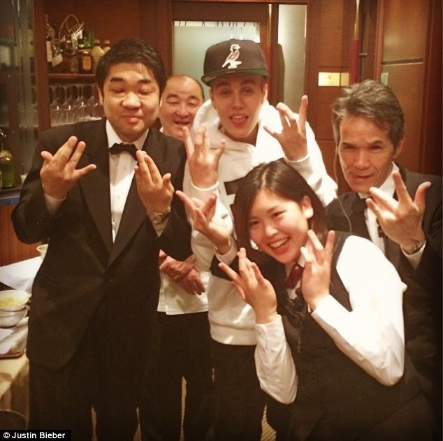 Holiday: The popstar poses in Japan - he has regularly been updating his Instagram page with photos from his trip