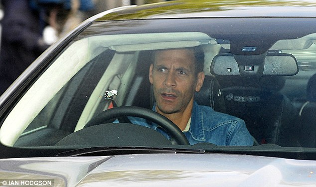 Come in No 5: Rio Ferdinand arrives for training the day after Moyes was sacked by United
