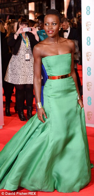 Lupita wowed at the EE British Academy Film Awards in London in emerald green Christian Dior