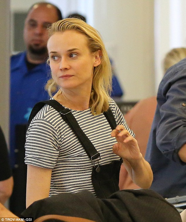 Natural: The Inglourius Basterds star went fresh-faced, showing her flawless skin as she lined up for airport secrurity