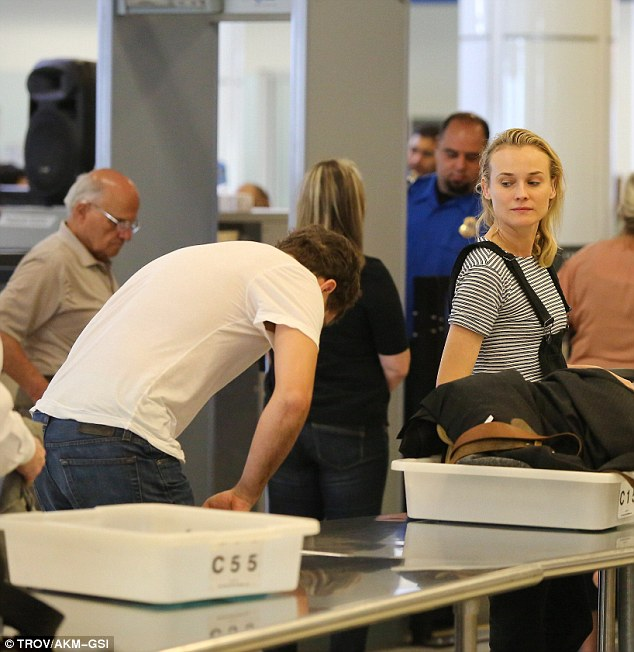 Long process: Diane Kruger and Joshua Jackson make their way through security at LAX on Thursday