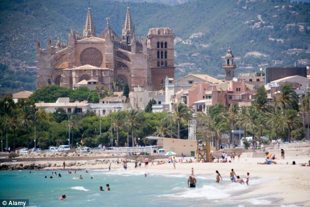 The woman was rushed to hospital after the plane landed on the island of Palma de Mallorca, pictured. Both the mother and baby are said to be stable
