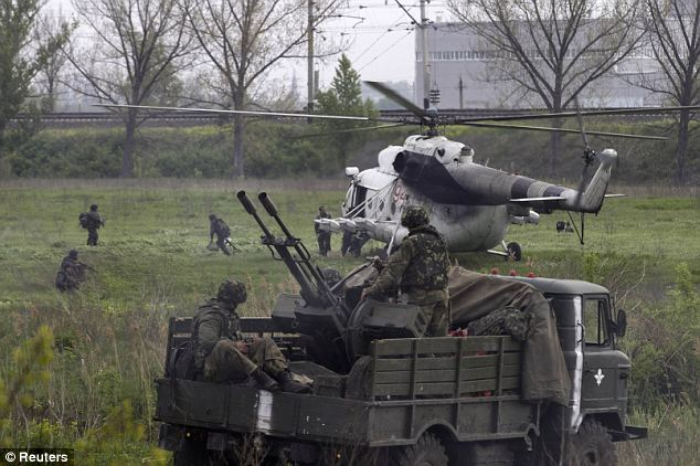 Missiles: The first gunship was blasted out of the sky with a surface-to-air missile over the city of Slaviansk this morning, Ukraine's Security Service said, while the other was forced to land under heavy attack