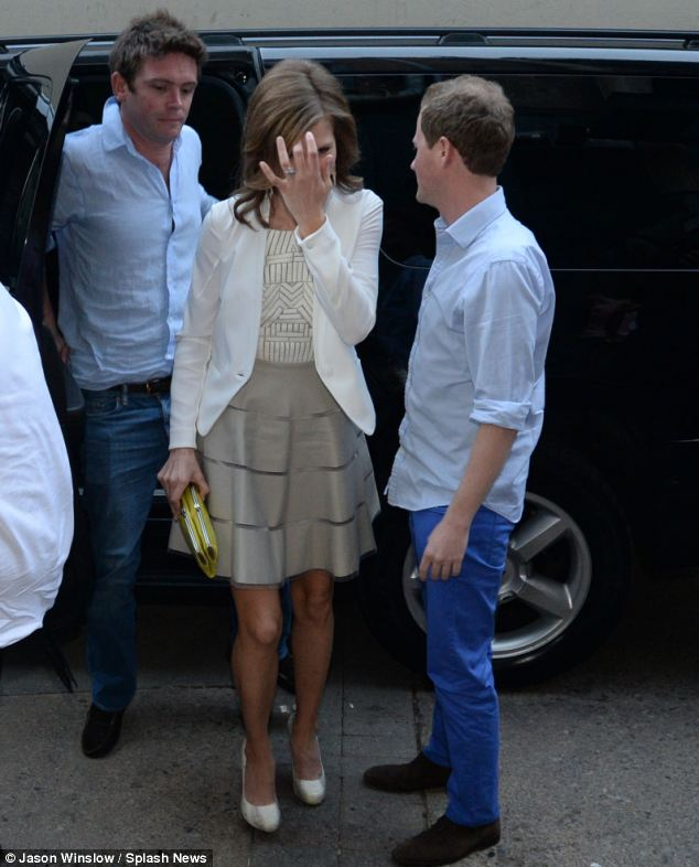 Her soon-to-be husband Guy looked relaxed in a crisp blue shirt and royal blue trousers