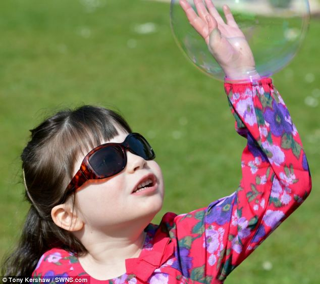 Bright light and wind can also trigger Neve's seizures so she has to wear sunglasses when she goes out and she has to stay inside when it is windy