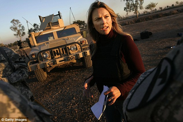 Future remains in question: Journalist Lara Logan of CBS News, pictured in Camp Victory in Baghdad, Iraq November 17, 2006, has still not returned to 60 Minutes since she broadcast a story on the Benghazi attack that turned out to be fabricated