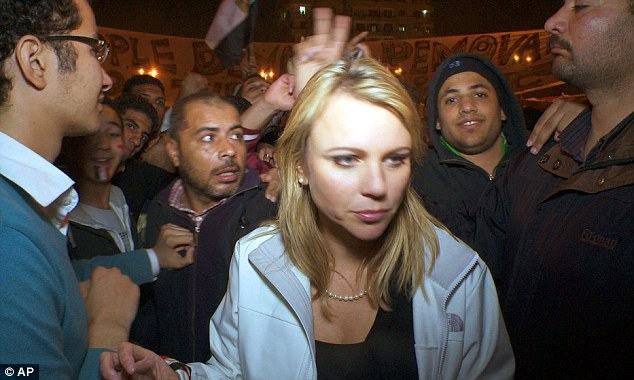 Assault: In this February 11, 2011 photo released by CBS, 60 Minutes correspondent Lara Logan is shown covering the reaction in in Cairo's Tahrir Square the day Egyptian President Hosni Mubarak stepped down. CBS News says Logan was attacked, and suffered a brutal beating and sexual assault before being saved by a group of women and an estimated 20 Egyptian soldiers