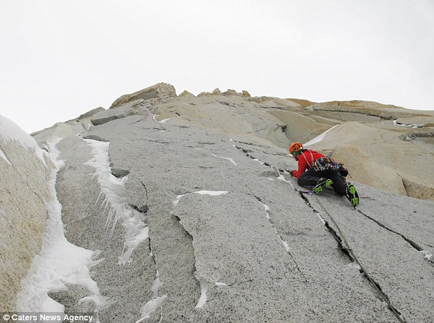 Sheer effort: Calum Muskett edges his way up to the summit