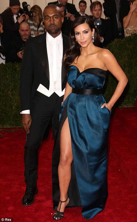How sweet: Kim and her fiance Kanye West, who will be having a wedding later this month but are said to have already officially exchanged vows, looked more in love than ever