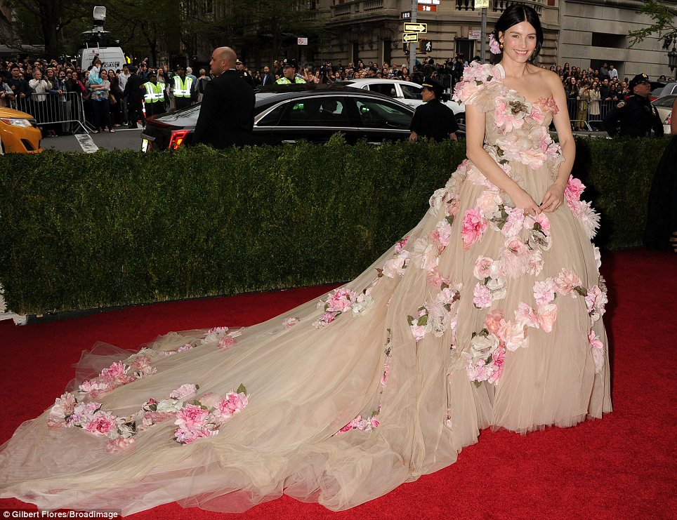 Fabulous florals: Designer Tabitha Simmons appeared to be attempting to steal the spotlight from the celebrities