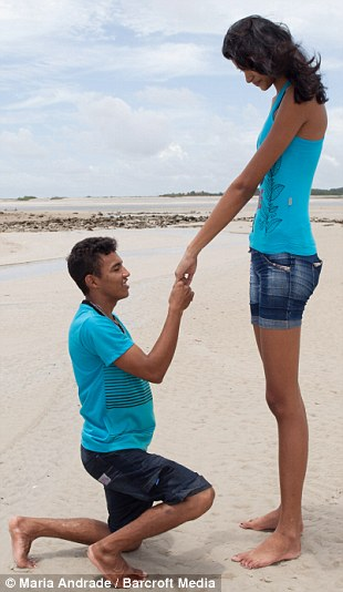 Brazil's tallest teen Elisany Da Silva accepts her new fiancee Francinaldo Carvalho's proposal on March 29, 2014 in Salinopolis, Brazil